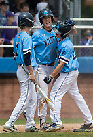 NWA Democrat-Gazette/BEN GOFF @NWABENGOFF<br /> Carter Carlton (from left), Clay Burtrum and Rally Miller of Springdale Har-Ber celebrate after Burtrum and Miller scored on a triple by Charlie Acuff (not pictured) in the 4th inning vs Fayetteville Friday, May 10, 2019, during the class 6A state baseball tournament at Veterans Park in Rogers.
