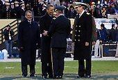 United States President Barack Obama, center, Secretary of Defense Leon Panetta, left, and Admiral Michael Miller, Superintendent of the Naval Academy, right, cross the field during half time to meet Lieutanant General David Huntoon, Superintendent of the U.S. Military Academy, center right, during the 112th Army-Navy Football game at FedEx Field in Landover, Maryland on Saturday, December 10, 2011..Credit: Kristoffer Tripplaar  / Pool via CNP