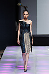 Model walks runway in an outfit from the Geraldus Sugeng collection for Couture Fashion Week Spring 2018 at the Crowne Plaza Times Square in Manhattan, on September 8, 2017; during New York Fashion Week.