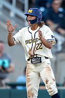 Michigan Wolverines outfielder Jordan Brewer (22) celebrates after scoring against the Vanderbilt Commodores during Game 1 of the NCAA College World Series Finals on June 24, 2019 at TD Ameritrade Park in Omaha, Nebraska. Michigan defeated Vanderbilt 7-4. (Andrew Woolley/Four Seam Images)