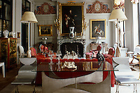 The grand salon of antique dealer Luc Bouveret's apartment reflects his eclectic taste in the melange of contemporary metal and glass pieces with antiques