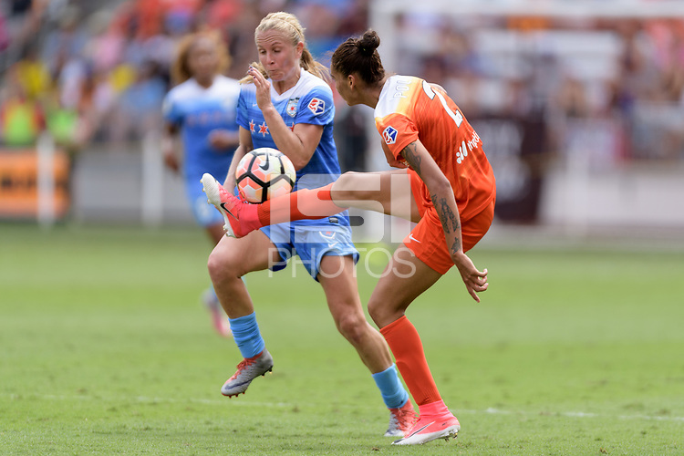 Houston, TX - Saturday April 15, 2017: Poliana attempts to clear the ball during a regular season National Women's Soccer League (NWSL) match won by the Houston Dash 2-0 over the Chicago Red Stars at BBVA Compass Stadium.