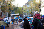 Occupy Amsterdam demonstration outside the Amsterdam Stock Exchange at Beursplein, Amsterdam, the Netherlands. This is one of many 'occupy' protests fallowing the Occupy Wall Street protests in New York, against economic inequality. October 19th 2011.