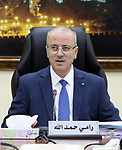 Palestinian Prime Minister Rami Hamdallah chairs a meeting of council of Ministers in the West Bank city of Ramallah, on June 20, 2017. Photo by Prime Minister Office