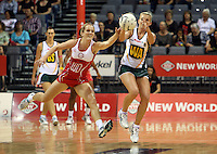 01.11.2012 South Africa's Nadia Uys and England's Sara Bayman in action during the netball test match between England and South Africa as part of the Quad Series played at the Claudelands Arena in Hamilton. Mandatory Photo Credit ©Michael Bradley.