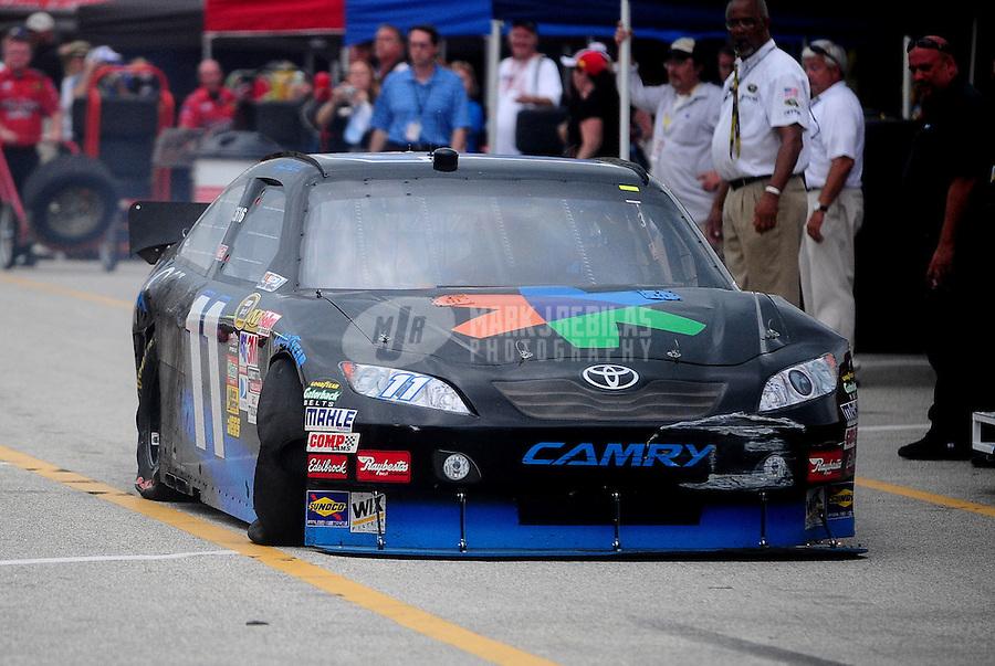 Jul. 1, 2010; Daytona Beach, FL, USA; NASCAR Sprint Cup Series driver Denny Hamlin drives through the garage after crashing during practice for the Coke Zero 400 at Daytona International Speedway. Mandatory Credit: Mark J. Rebilas-