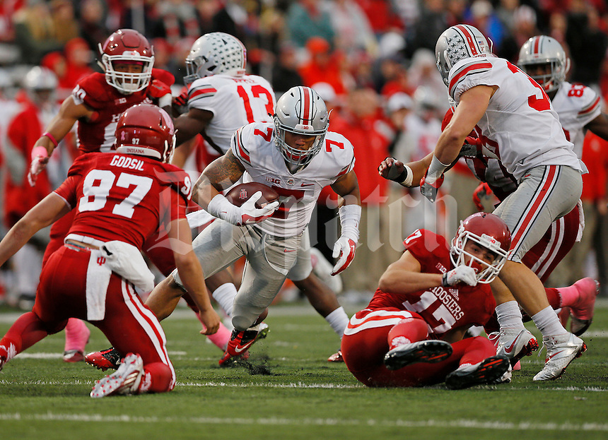 Ohio State Buckeyes running back Jalin Marshall (7)of the Ohio State Buckeyes spins around to tries to outrun the Indiana defense in the second half of Ohio State Buckeyes against the Indiana Hoosiers at Memorial Stadium in Bloomington Indiana Oct. 3, 2015.(Dispatch photo by Eric Albrecht)