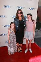 Tiffany Amber Thiessen and friends daughters<br /> at Disney's &quot;Cinderella&quot; Advance Screening, Disney Main Theater, Burbank, CA 03-08-15<br /> David Edwards/DailyCeleb.com 818-249-4998
