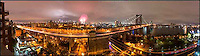 Williamsburg Bridge, Manhattan skyline, East River, FDR Drive during 4th of July fireworks celebration, NYC