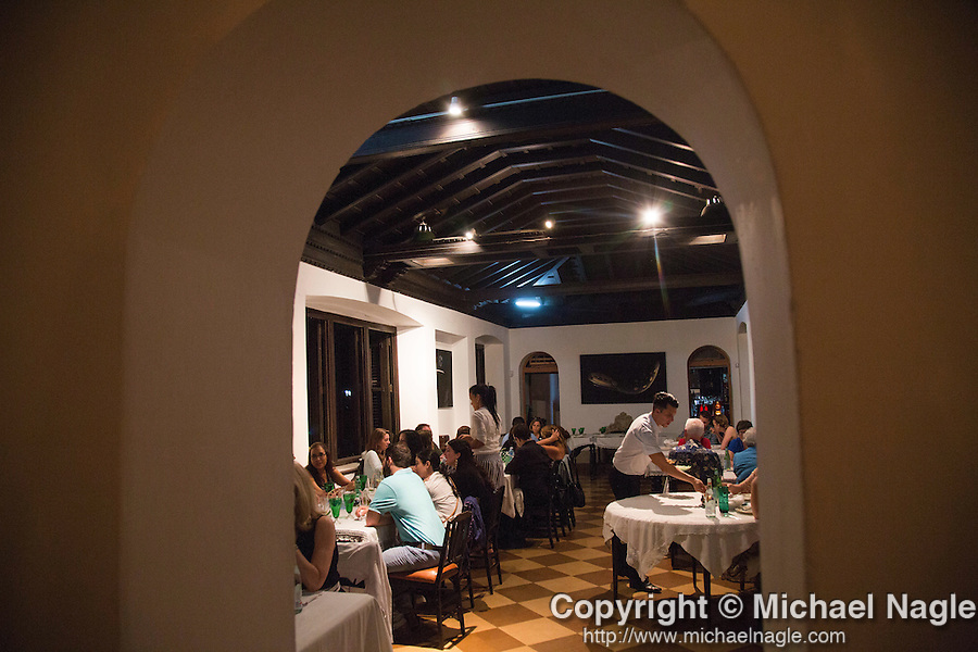 HAVANA, CUBA -- MARCH 22, 2015:   Diners eat at Atelier in the Vedado neighborhood of Havana, Cuba on March 22, 2015. Photograph by Michael Nagle
