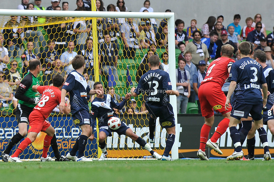 MELBOURNE, AUSTRALIA - JANUARY 09: Marvin Angulo of the Victory blocks a kick on goal during the round 22 A-League match between the Melbourne Victory and Adelaide United at AAMI Park on January 9, 2011 in Melbourne, Australia. (Photo by Sydney Low / Asterisk Images)