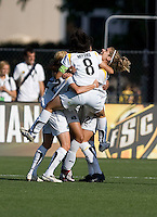 Aya Miyama (8) jumps onto her teammates after the LA Sol goal. Los Angeles Sol defeated FC Gold Pride 2-0 at Buck Shaw Stadium in Santa Clara, California on May 24, 2009.