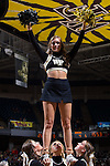 A member of the Wake Forest Demon Deacons cheer leading squad entertains the crowd during a first half timeout in the game against the UNC Asheville Bulldogs at the LJVM Coliseum on November 14, 2014 in Winston-Salem, North Carolina.  The Demon Deacons defeated the Bulldogs 80-69  (Brian Westerholt/Sports On Film)