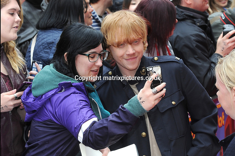 NON EXCLUSIVE PICTURE: PAUL TREADWAY / MATRIXPICTURES.CO.UK<br /> PLEASE CREDIT ALL USES<br /> <br /> WORLD RIGHTS<br /> <br /> English actor Rupert Grint attends the World Premiere of Postman Pat: The Movie, Odeon West End, London.<br /> <br /> MAY 11th 2014<br /> <br /> REF: PTY 142244