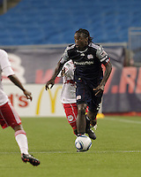 New England Revolution midfielder Shalrie Joseph (21) on the attack. The New England Revolution defeated the New York Red Bulls, 3-2, at Gillette Stadium on May 29, 2010.