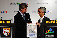 USA Bid Committee Chairman Sunil Gulati (R) presents FIFA representative Harold Mayne-Nicholls (L) with a pennant at the St. Regis Hotel in New York, NY, on September 07, 2010.