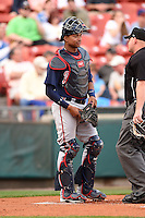 Gwinnett Braves catcher Christian Bethancourt (27) talks with umpire Jonathan Bailey during a game against the Buffalo Bisons on May 13, 2014 at Coca-Cola Field in Buffalo, New  York.  Gwinnett defeated Buffalo 3-2.  (Mike Janes/Four Seam Images)