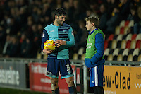 Joe Jacobson of Wycombe Wanderers chats with a ballboy during the Sky Bet League 2 match between Newport County and Wycombe Wanderers at Rodney Parade, Newport, Wales on 22 November 2016. Photo by Mark  Hawkins.