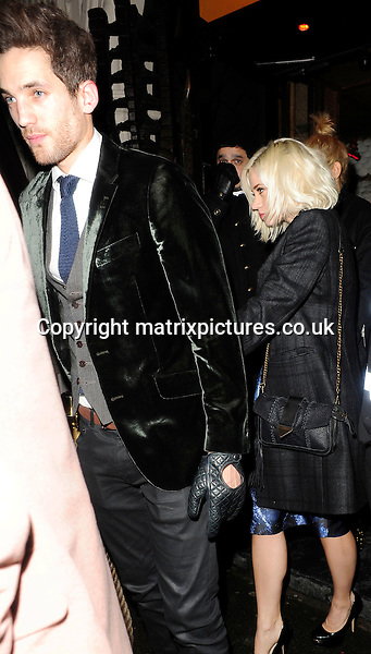 NON EXCLUSIVE PICTURE: MATRIXPICTURES.CO.UK.PLEASE CREDIT ALL USES..WORLD RIGHTS..Pictures show American singer and Pussycat Doll Kimberley Wyatt celebrating her 31st Birthday with her boyfriend Max Rogers and fellow Pussycat Doll, Ashley Roberts...The group left the nightclub Mahiki at 3am and went back to their hotel in London. ..Pictured here, is American singer Kimberley Wyatt and her boyfriend Max Rogers...FEBRUARY 4th 2013..REF: ASI 13741