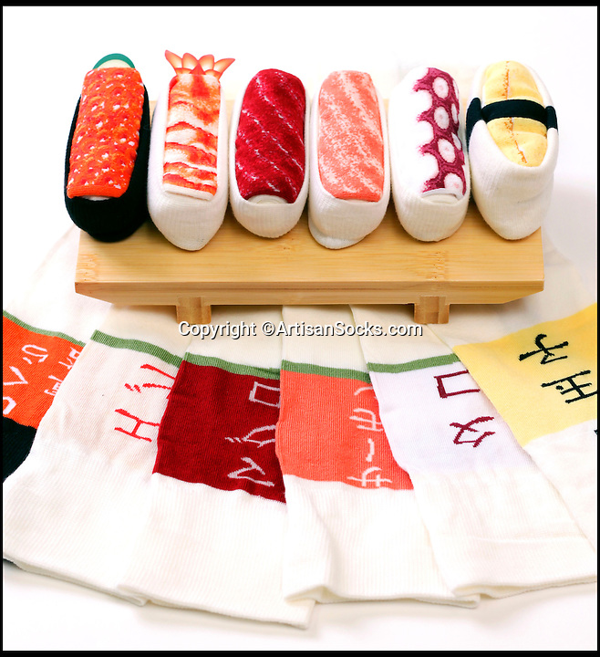 BNPS.co.uk (01202 558833)<br /> Pic: ArtisanSocks/BNPS<br /> <br /> ***Must Use Full Byline***<br /> <br /> Soft Sushi Shuffle...<br /> <br /> (L-R): Salmon Roe, Tuna Maguro, Tamago Egg, Octopus Tako, Salmon and Shrimp Ebi sushi socks. <br /> <br /> Now, should you wish to, you can make your sock draw look like a sushi bar.<br /> <br /> These morsels of mouthwatering sushi might look tantalising but you wouldn't want to eat them - because they're actually rolled up socks.<br /> <br /> The super-realistic items of clothing are the latest bizarre trend sweeping the fashion world and have been an instant hit with shoppers.<br /> <br /> Unrolled they look like any other sock but rolled up they form seven different varieties of the raw fish snack, transforming your underwear drawer into a smorgasbord of sushi.<br /> <br /> The life-like 'flavours' include egg (tamago), salmon roe (ikura), shrimp (ebi), octopus (tako), tuna (maguro ), salmon (sa-mon) and trout (masuzishi).<br /> <br /> Sushi socks cost $6 a pair - around £3.70 - and can be bought from artisansocks.com.