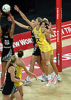 19.09.2013 Silver Ferns Maria Tutaia and Australian Diamonds Laura Geitz in action during the Silver Ferns V Australian Diamonds New World Netball Series played at Vector Arena in Auckland. Mandatory Photo Credit ©Michael Bradley.