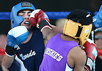 Nevada's Gabe Mejorado and University of Washington's Devin Bell compete in an intercollegiate boxing match at TJ's Corral at Carson Valley Inn, in Minden, Nev., on Saturday, Sept. 13, 2014. Mejorado won the bout.<br /> Photo by Cathleen Allison