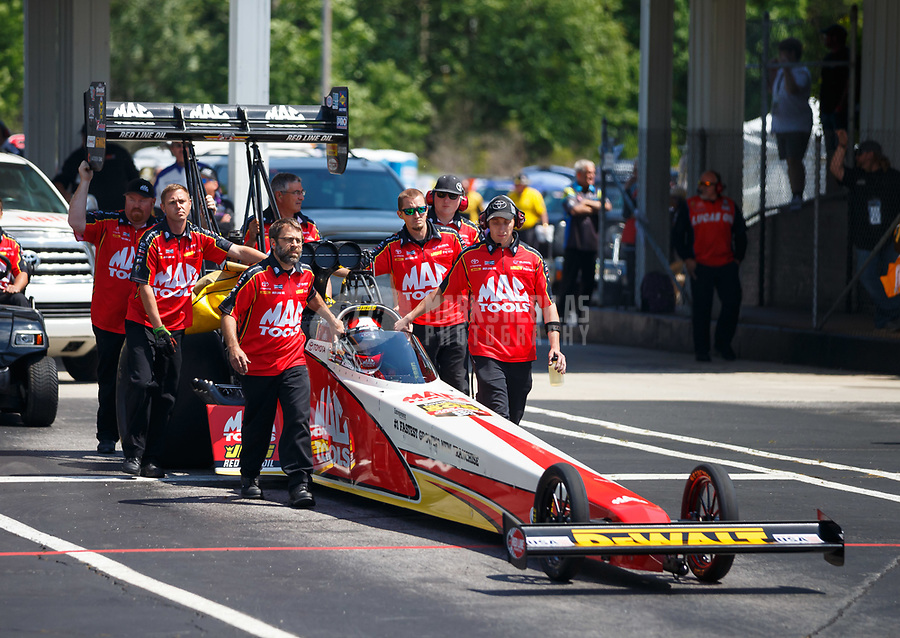 May 6, 2017; Commerce, GA, USA; Crew members with NHRA top fuel driver Doug Kalitta during qualifying for the Southern Nationals at Atlanta Dragway. Mandatory Credit: Mark J. Rebilas-USA TODAY Sports