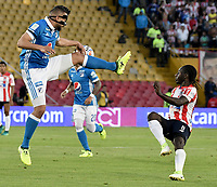 BOGOTA - COLOMBIA -06 -08-2017: Andres Cadavid (Izq) jugador de Millonarios disputa el balón con Yimmi Chara (Der) jugador de Atlético Junior durante partido por la fecha 6 de la Liga Aguila II 2017 jugado en el estadio Nemesio Camacho El Campin de la ciudad de Bogota. / Andres Cadavid (L) player of Millonarios fights for the ball with Yimmi Chara (R) player of Atletico Junior during match for the date 6 of the Liga Aguila II 2017 played at the Nemesio Camacho El Campin Stadium in Bogota city. Photo: VizzorImage / Gabriel Aponte / Staff.
