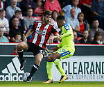 Ched Evans of Sheffield Utd and Marcus Olsson of Derby County during the Championship match at Bramall Lane, Sheffield. Picture date 26th August 2017. Picture credit should read: Simon Bellis/Sportimage