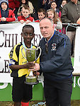 Drogheda Town captain Femi fanifosi is presented with  under 13 cup by Turlough Maher after his team beat Walshestown in the DDSL cup final in United Park. Photo:Colin Bell/pressphotos.ie