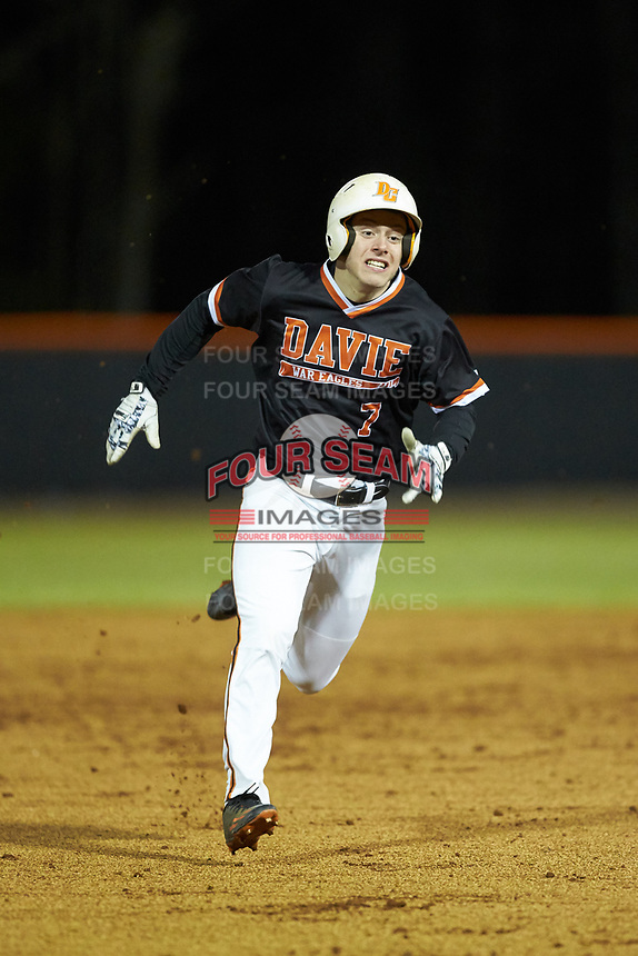 Garrett Chandler (7) of the Davie War Eagles legs out a triple during the game against the Lake Norman Wildcats at Davie County High School on March 7, 2018 in Mocksville, North Carolina.  The Wildcats defeated the War Eagles 12-0.  (Brian Westerholt/Four Seam Images)