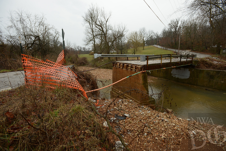 NWA Democrat-Gazette/ANDY SHUPE<br />A bridge along Pump Station Road north of J.B. Hunt Park in Springdale was damaged by flooding, requiring it to be replaced.