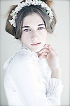 Close up of young girl wearing white
