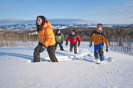 Friends snowshoeing and winter fun at Fox Creek Wilderness Bed and Breakfast near Lake Laberge, Whitehorse, Yukon