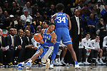 WINSTON-SALEM, NC - JANUARY 23: Duke's Trevon Duval (1) uses a pick set by Wendall Carter, Jr. (34). The Wake Forest University Demon Deacons hosted the Duke University Blue Devils on January 23, 2018 at Lawrence Joel Veterans Memorial Coliseum in Winston-Salem, NC in a Division I men's college basketball game. Duke won the game 84-70.