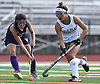 Alexis Ruiz #1 of Carle Place, right, gets pressured by Anna Silver #4 of Oyster Bay during the Nassau County varsity field hockey Class C final at Berner Middle School in Massapequa on Sunday, Oct. 28, 2018. Carle Place won 6-0.