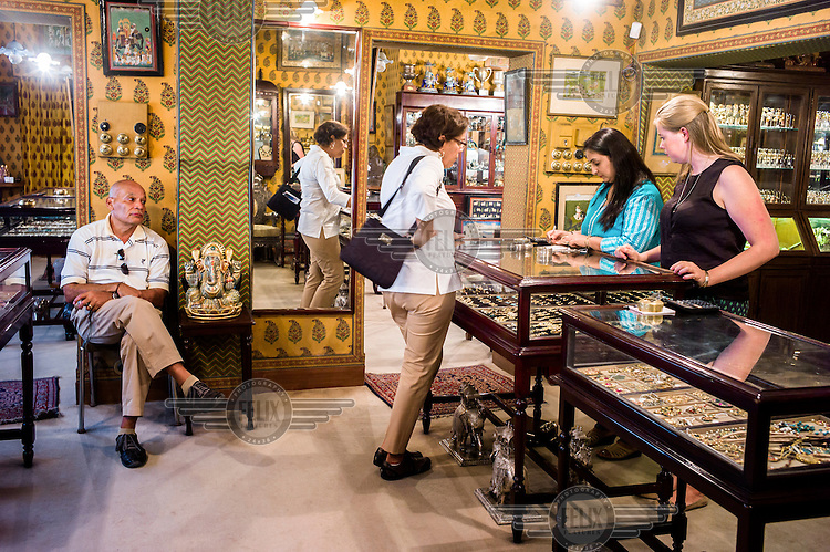 Shoppers browse through expensive jewellery at The Gem Palace in Jaipur.