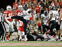 Cincinnati Bearcats defensive lineman Silverberry Mouhon (92) celebrates tackling Ohio State Buckeyes quarterback J.T. Barrett (16) during the third quarter of the NCAA football game at Ohio Stadium in Columbus on Sept. 27, 2014. (Adam Cairns / The Columbus Dispatch)