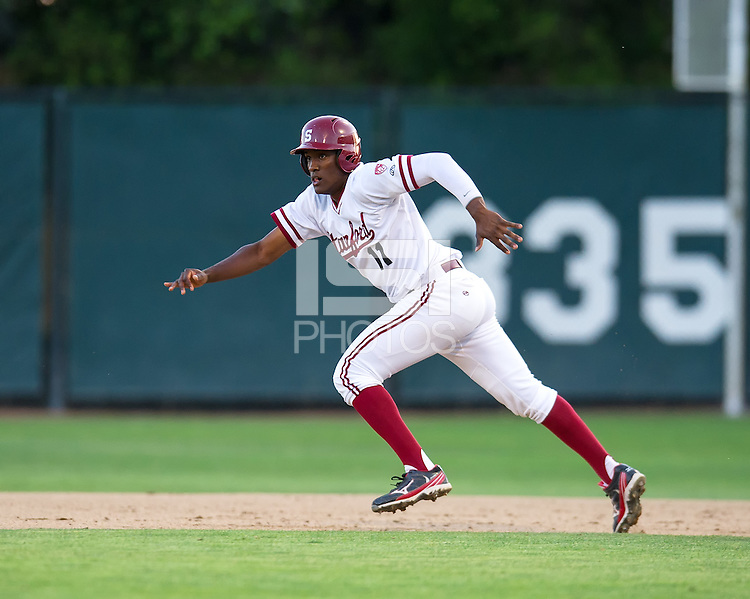 STANFORD, CA - April 19, 2013: Stanford first baseman Brian Ragira (11) running to 2nd during the Stanford vs Arizona baseball game at Sunken Diamond in Stanford, California. Final score, Stanford 4, Arizona 3.