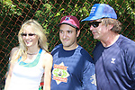 Alec Baldwin (The Doctors) and 30 Rock poses with Lori Singer (Footloose and Fame) and Greg Bello (30 Rock) at the 63rd Annual Charity Softball Game 2011 - Artists versus Writers to benefit East Hampton Day Care Learning Center, East End Hospice and Phoenix Houses of Long Island - played at Herrick Park, East Hampton, New York. (Photo by Sue Coflin/Max Photos)