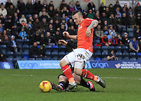 A last ditch tackles denies Jack Marriott of Luton Town a goal scoring opportunity during the Sky Bet League 2 match between Wycombe Wanderers and Luton Town at Adams Park, High Wycombe, England on 6 February 2016. Photo by Liam Smith.