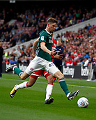30th September 2017, Riverside Stadium, Middlesbrough, England; EFL Championship football, Middlesbrough versus Brentford; Chris Mepham of Brentford clears on his full debut in the 2-2 draw