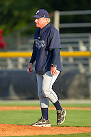 Princeton Rays pitching coach Marty DeMerritt #41 walks to the mound to talk to his pitcher during an Appalachian League game against the Burlington Royals at Burlington Athletic Stadium July 11, 2010, in Burlington, North Carolina.  Photo by Brian Westerholt / Four Seam Images