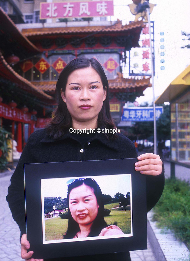 Gou Xiao holds a picture showing her before her eye widening operation in Shenzhen, China. As the Chinese population grows richer more and people are turning to cosmetic surgeons for nose, eye and breast jobs...PHOTO BY SINOPIX