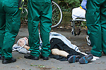 © Joel Goodman - 07973 332324 . 16 August 2013 . Manchester , UK . 15 year old named Connor , wearing a tag , being tended to by paramedics after suffering a severe leg break in Wythenshawe Park following a motorbike crash . Drive along with Inspector Matt Bailey-Smith ( 16366 ) of Greater Manchester Police 's Serious Collision Unit . Photo credit : Joel Goodman