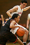 Gladstone guard Trevor Browing (5) brings the ball up court against La Salle Prep guard Luke Kolln (20) in the first half at La Salle High School.<br /> Photo by Jaime Valdez
