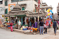 Patan, Nepal.  Street Scene Opposite Durbar Square.  Dresses and Fruit for Sale.
