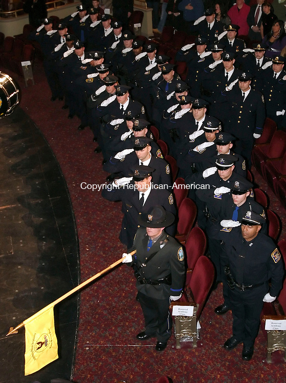 WATERBURY, CT 12/07/07- 120707BZ08- The Basic Police Recruit Class 2007-01 salute the flag during the National Anthem at the Waterbury Police Department Police Academy graduation excercises at the Palace Theater Friday night. <br /> Jamison C. Bazinet Republican-American