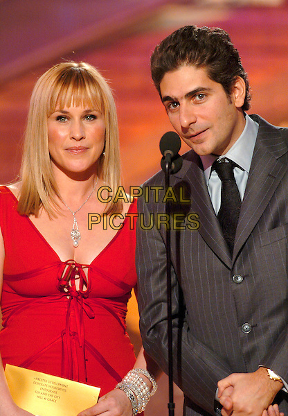PARTICIA ARQUETTE & MICHAEL IMPERIOLI.62nd Annual Golden Globe Awards, Beverly Hills, Los Angeles, California.January 16th, 2005.half length,  microphone, stage, red, grey, gray suit jacket.www.capitalpictures.com.sales@capitalpictures.com.Supplied by Capital Pictures.