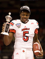 Louisville quarterback Teddy Bridgewater wins the Most Outstanding Player trophy after winning 79th Sugar Bowl game against Florida at Mercedes-Benz Superdome in New Orleans, Louisiana on January 2nd, 2013.   Louisville Cardinals defeated Florida Gators, 33-23.